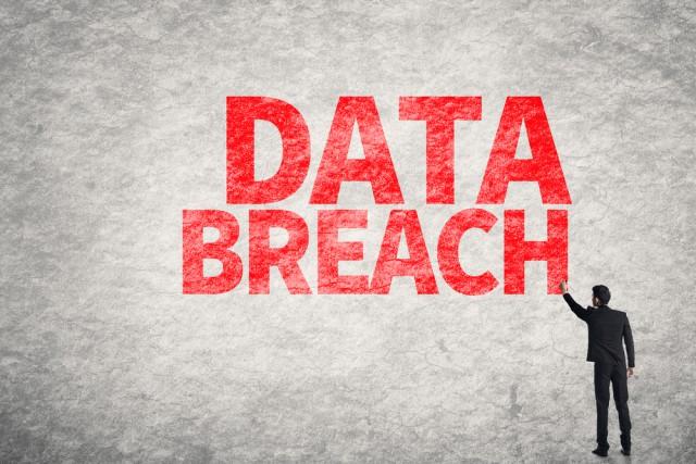 Data-breach-wall-writing-man-e1450184052868
